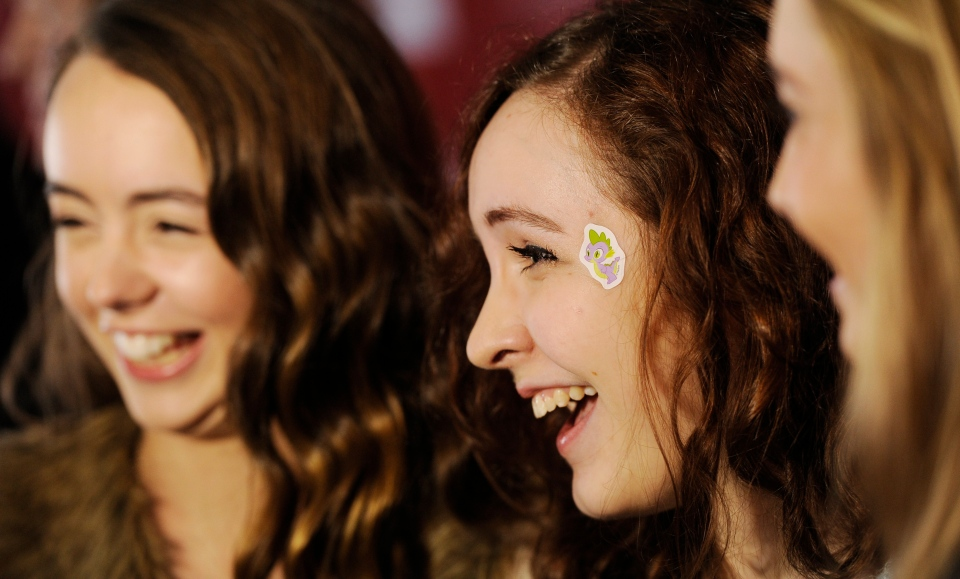 """Helena Seabrook, middle, a cast member in """"Ping Pong Summer,"""" is interviewed alongside fellow cast members Maddie Howard, left, and Emmi Shockley at the premiere of the film at the 2014 Sundance Film Festival on Saturday, Jan. 18, 2014, in Park City, Utah. (Photo by Chris Pizzello/Invision/AP)"""