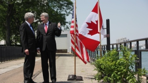 Prime Minister Stephen Harper and Michigan Gov. Rick Snyder speak in Windsor, Ont., on Friday, June 15, 2012, ahead of an announcement for a new $1-billion bridge connecting the city with Detroit. (Colin Perkel / THE CANADIAN PRESS)