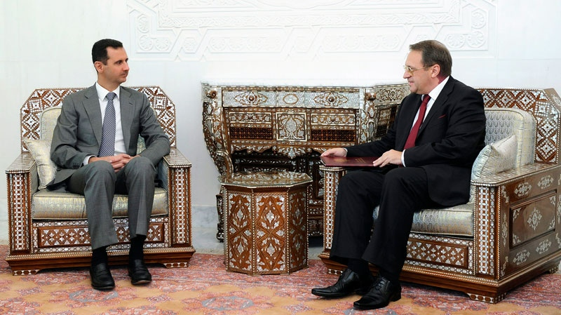 In this photo released by the Syrian official news agency SANA, Syrian President Bashar Assad, left, meets with senior Russian envoy Mikhail Bogdanov, right, who expressed Moscow's support for Assad's plans for reform in Syria, at the presidential palace in Damascus, on Monday Aug. 29, 2011. (AP / SANA)