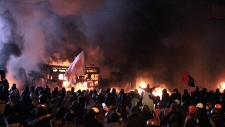 Protesters clash with riot police in central Kyiv