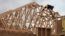 A construction worker works on a house in a new housing development in Oakville, Ont., Friday, April 29. 2011. Richard Buchan / THE CANADIAN PRESS)