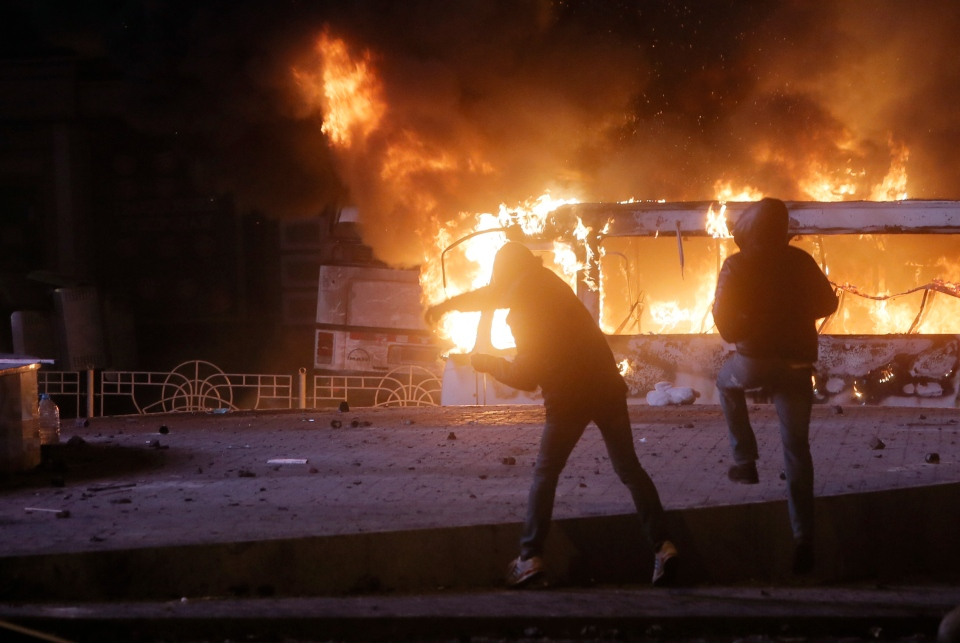 Protesters throw stones during clashes with police, in central Kyiv, Ukraine, early Monday, Jan. 20, 2014. (AP / Efrem Lukatsky)