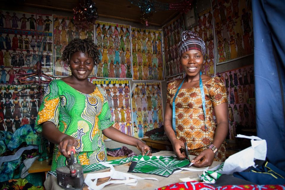 Two tailoring graduates of the Children's Voice Centre in Goma, Democratic Republic of Congo. (Paul Bettings for World VIsion)