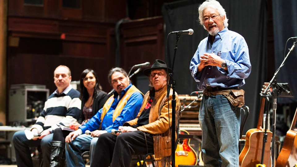 "Environmentalist David Suzuki, right, speaks in front of climate scientist Andrew Weaver, left, indigenous rights advocate Eriel Derenger, second left, Athabasca Chipewyan Chief Allan Adam, centre, and singer Neil Young, during a press conference for the ""Honour the Treaties"" tour, in Toronto, Sunday, Jan. 12, 2014. (Mark Blinch / THE CANADIAN PRESS)"