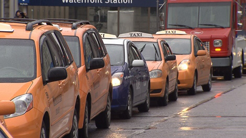 Taxis line up outside Waterfront Station in downtown Vancouver in this January 2014 file photo. (CTV)