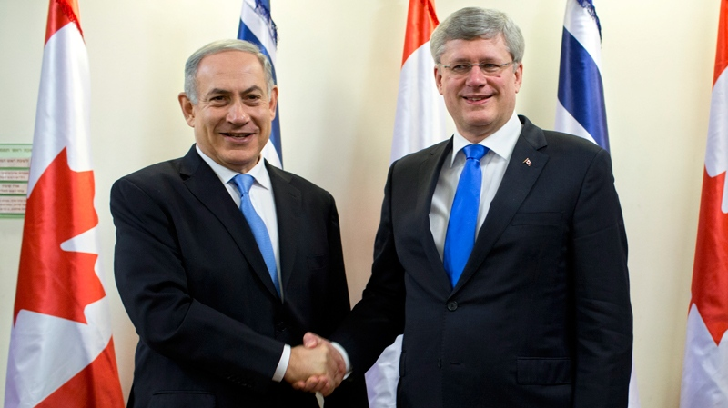 Israeli Prime Minister Benjamin Netanyahu, left, and Canadian Prime Minister Stephen Harper, shake hands ahead of their meeting at the Prime Minister's office in Jerusalem, Tuesday, Jan. 21, 2014. (AP / Oded Balilty)