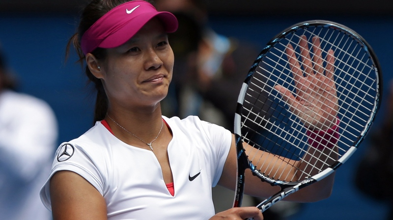 Li Na of China celebrates after defeating Flavia Pennetta of Italy during their quarterfinal at the Australian Open tennis championship in Melbourne, Australia, Tuesday, Jan. 21, 2014. (AP / Aaron Favila)