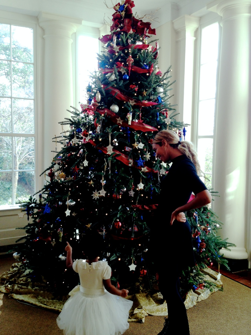 Beyonce and her daughter, Blue Ivy, stand by a Christmas tree at the White House in Washington, Saturday, Jan. 18, 2014. (beyonce.com/tumblr)