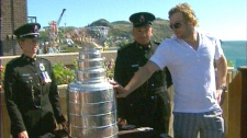 The storied Stanley Cup is sporting a new dent today after toppling from a table in Newfoundland, Tuesday, Aug. 30, 2011.