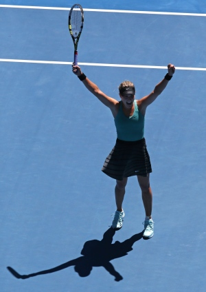 Eugenie Bouchard raises her arms some more after b