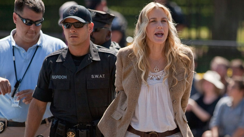 Daryl Hannah is arrested by U.S. Park Police in front of the White House in Washington, Tuesday, Aug. 30, 2011, during a protest against the Keystone oil pipeline. (AP / Evan Vucci)