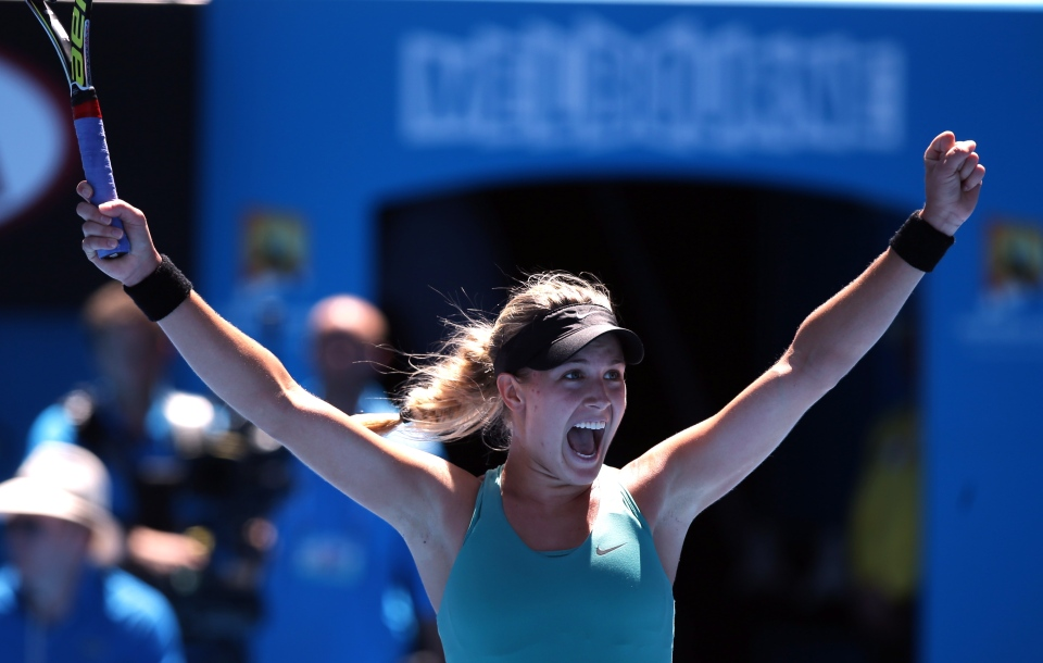Eugenie Bouchard of Canada celebrates after defeating Ana Ivanovic of Serbia during their quarterfinal at the Australian Open tennis championship in Melbourne, Australia, Tuesday, Jan. 21, 2014.(AP Photo/Aaron Favila)