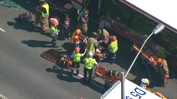 Emergency crews work at the scene of a serious crash involving a TTC bus, Tuesday, Aug. 30, 2011.