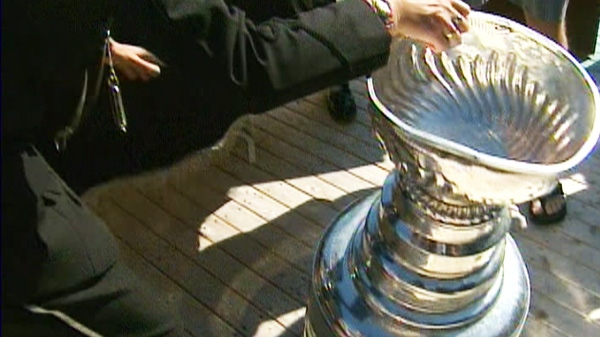 A dented Stanley Cup is seen moments after if fell over in Bonavista., N.L., the hometown of former Boston Bruin Michael Ryder, on Tuesday, Aug. 30, 2011.