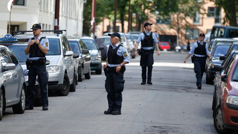 Police surround the crime scene following a shooting incident outside the Muslim Culture Institute mosque, in Copenhagen, Tuesday, Aug. 30. 2011. (AP / POLFOTO, Jens Dresling)