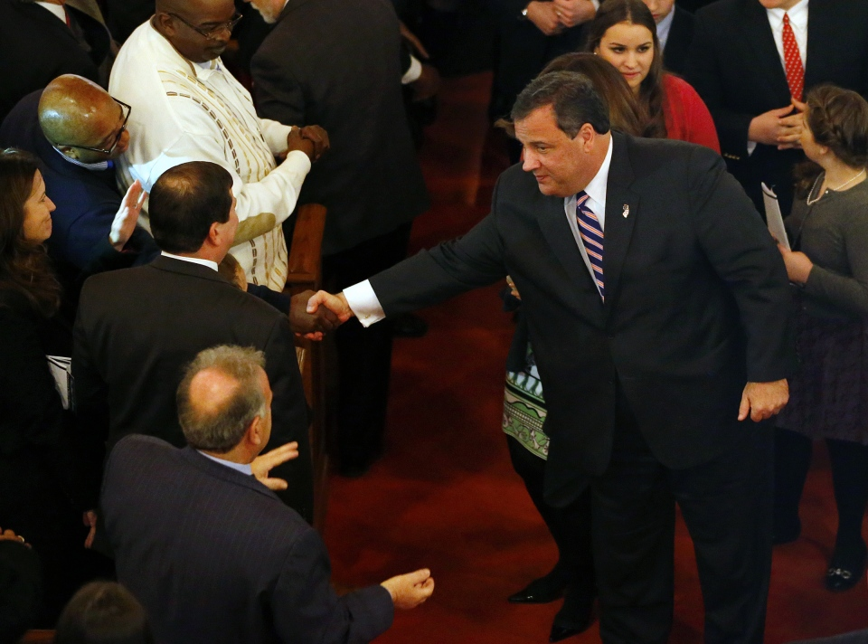 New Jersey Gov. Chris Christie shakes hands as he leaves a prayer service in celebration of his inauguration at the New Hope Baptist Church on Tuesday, Jan. 21, 2014 in Newark. (AP / Rich Schultz)