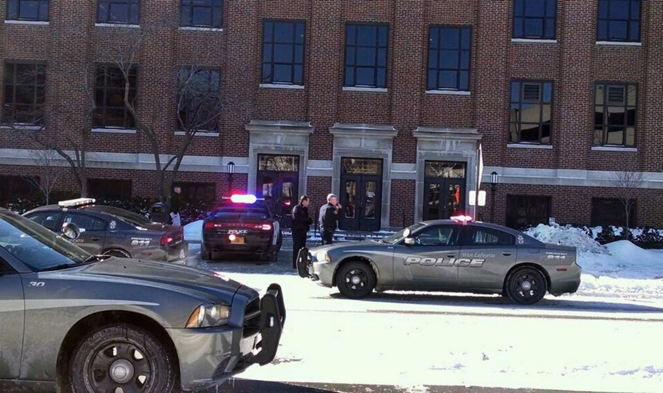 Police investigate a reports of a shooting at Purdue University in West Lafayette, Ind., on Tuesday, Jan. 21, 2014.  (AP / The Journal & Courier, John Terhune)
