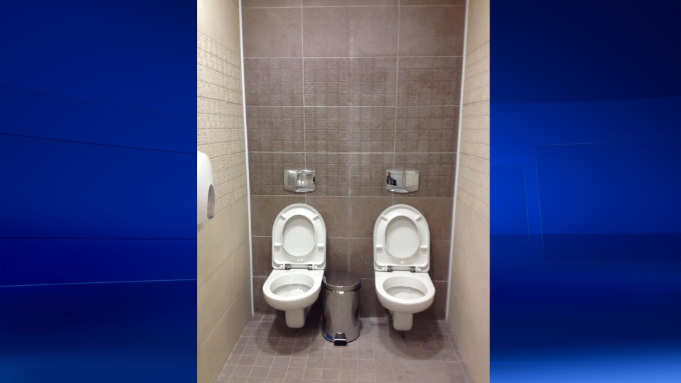 This photo from BBC's Moscow correspondent Steve Rosenberg shows two toilets sharing a stall at the Sochi Olympic Biathlon Centre. (Steve Rosenberg / Twitter)