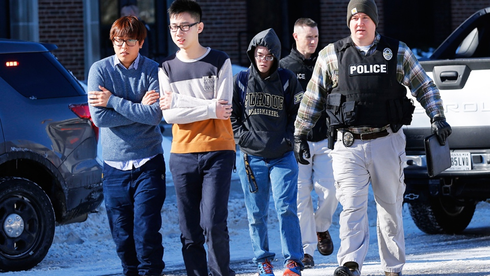 Police evacuate students from the Electrical Engineering building after shots were fired on the campus of Purdue University in West Lafayette, Ind. on Tuesday, Jan. 21, 2014. (AP / Journal & Courier, John Terhune)