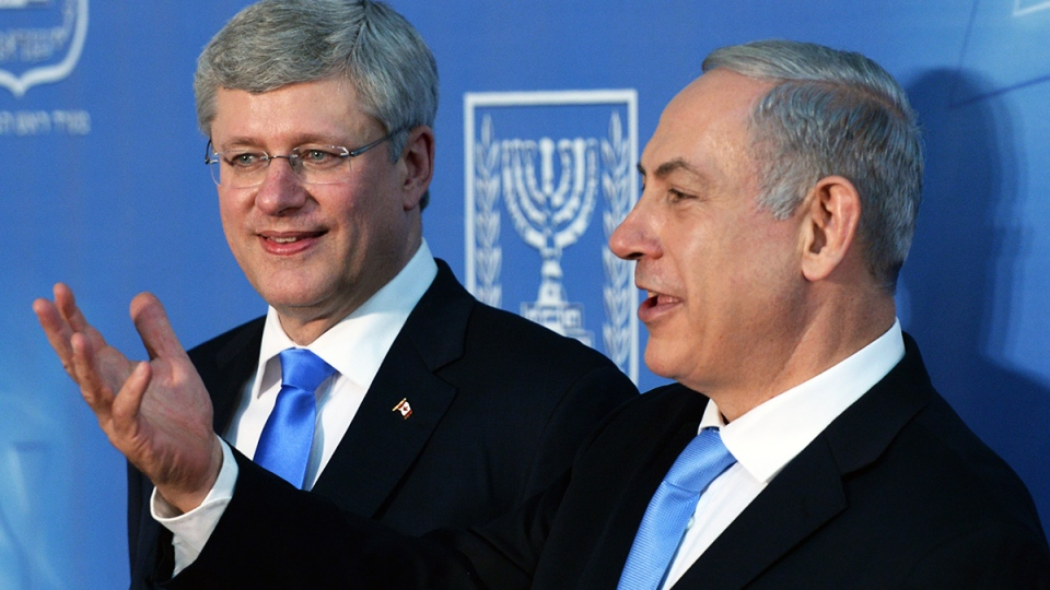 Prime Minister Stephen Harper and Israeli Prime Minister Benjamin Netanyahu talk following a joint press conference in Jerusalem, Israel on Tuesday, Jan. 21, 2014. (Sean Kilpatrick / THE CANADIAN PRESS)
