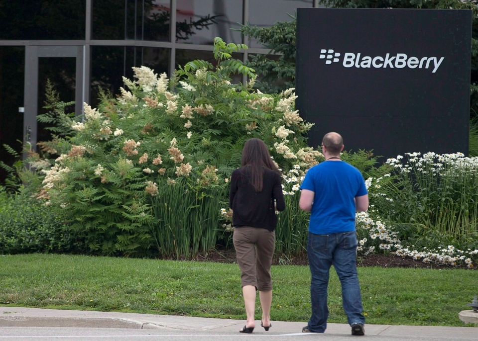 People walk past BlackBerry's headquarters in Waterloo, Ont. on July 9, 2013. (Geoff Robins / THE CANADIAN PRESS)