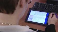 Tracey Messeum studies on her iPad