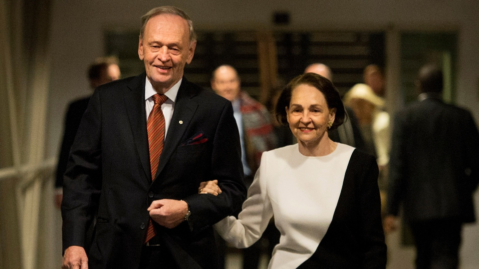 Former prime minister Jean Chretien, left, and his wife Aline Chretien walk into a the room during his 80th birthday and marking 50 years in public service in Toronto on Tuesday, Jan. 21, 2014. (The Canadian Press/Nathan Denette)