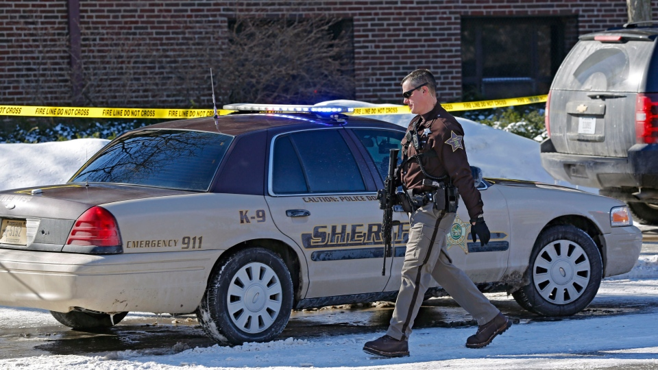 A member of the Tippecanoe County Sheriff's Office on the scene after shots were fired around noon Tuesday, Jan. 21, 2014, inside the Electrical Engineering Building on the campus of Purdue University, in West Lafayette, Ind. (Journal & Courier / John Terhune)