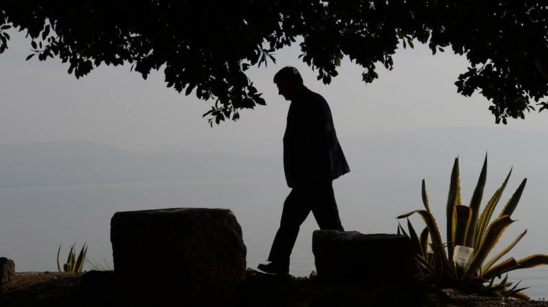 Prime Minister Stephen Harper walks along the shore of the Sea of Galilee as he visits Capernaum, Israel on Wednesday, Jan. 22, 2014. While in the Middle East Harper is visiting Israel, the West Bank, and Jordan. (Sean Kilpatrick / THE CANADIAN PRESS)