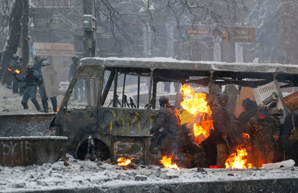 Protesters clash with police in central Kyiv, Ukraine, early Wednesday, Jan. 22, 2014. (AP / Sergei Grits)
