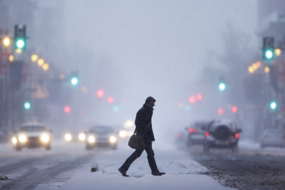 A man crosses Broad Street during a winter snowstorm Tuesday, Jan. 21, 2014, in Philadelphia. (AP / Matt Rourke)