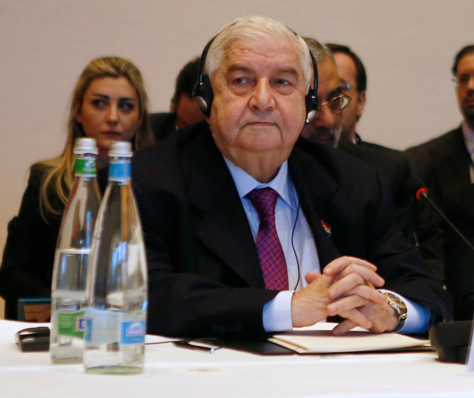 Syria's Foreign Minister Walid al-Moallem leads his delegation during a plenary session in Montreux, Switzerland, Wednesday Jan. 22, 2014. (AP / Gary Cameron)