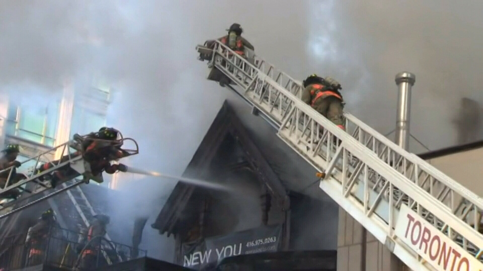 Firefighters are seen on the ground battling a large blaze in Yorkville, Wednesday, Jan. 22, 2014.