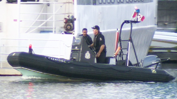 Police investigate after a foot and leg bone were found floating in the water along the shore of Vancouver's False Creek on Tuesday, Aug. 30, 2011.