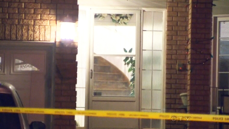 Police tape blocks off the scene of a stabbing in Brampton, Ont. on Tuesday, Jan. 21, 2014.