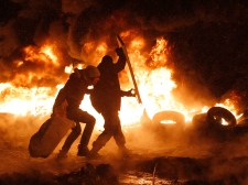 Protesters throw burning tires in Kyiv, Ukraine
