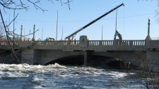 Water rushes and spills over the banks of the normally quiet Wascana Creek on Tuesday, April 12, 2011. (THE CANADIAN PRESS/Jennifer Graham)