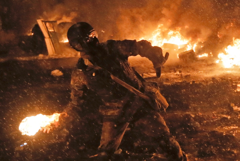 A protester throws a Molotov cocktail during clashes with police in central Kyiv, Ukraine, Wednesday, Jan. 22, 2014. (AP / Efrem Lukatsky)