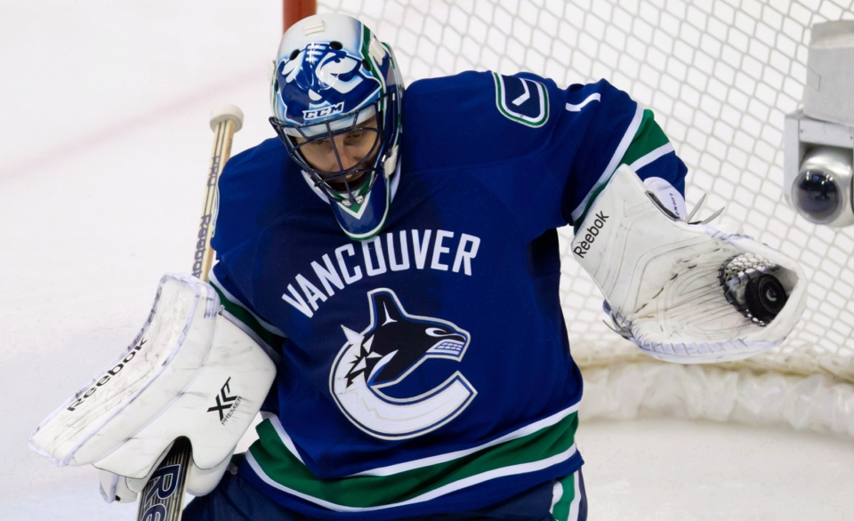 Vancouver Canucks' goalie Roberto Luongo makes a save in this December 2013 file photo.(Darryl Dyck/THE CANADIAN PRESS)