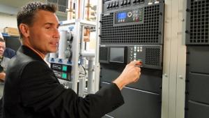 CTV Saskatchewan vice-president and general manager Wade Moffatt powers up a new digital transmitter at CTV Regina on Wednesday.