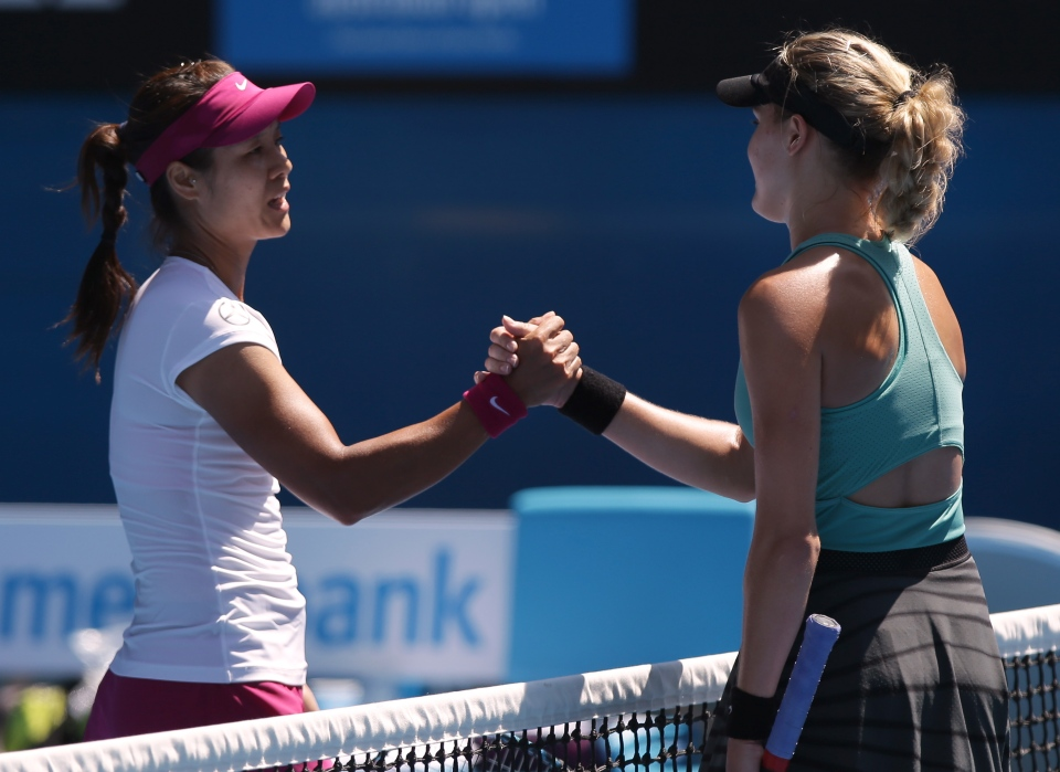 Li Na of China, left, shakes hands with Eugenie Bouchard of Canada at the net after her semifinal win at the Australian Open tennis championship in Melbourne, Australia, Thursday, Jan. 23, 2014.(AP Photo/Aaron Favila)