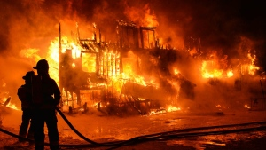 Fire crews respond to the seniors home fire in L'Isle-Verte, Quebec, approximately 230 kilometres northeast of Quebec City, Thursday, Jan. 23, 2014. (Francois Drouin)