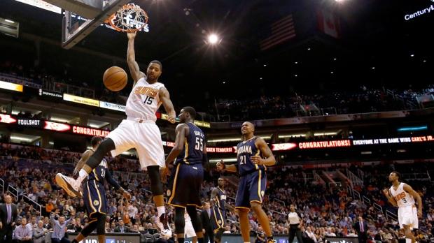 Suns' Marcus Morris (15) dunks in Phoenix