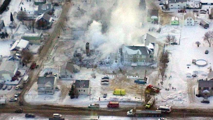 In this aerial photo from the Surete du Quebec, the burned down seniors home in the town of L'Isle-Verte is visible, Thursday, Jan. 23, 2014.