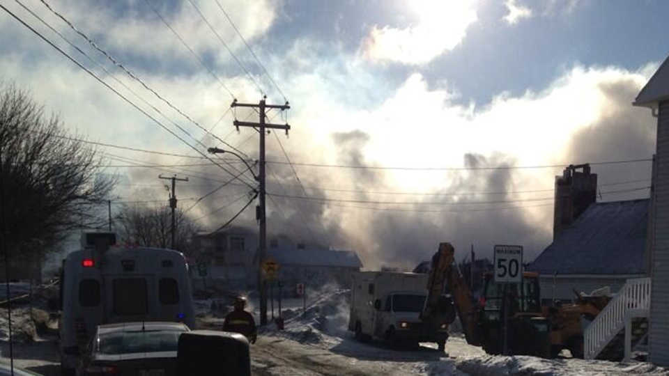 Smoke filled the air in L'Isle Verte ten hours after a fire began at the Residence du Havre (Jan. 23, 2014)