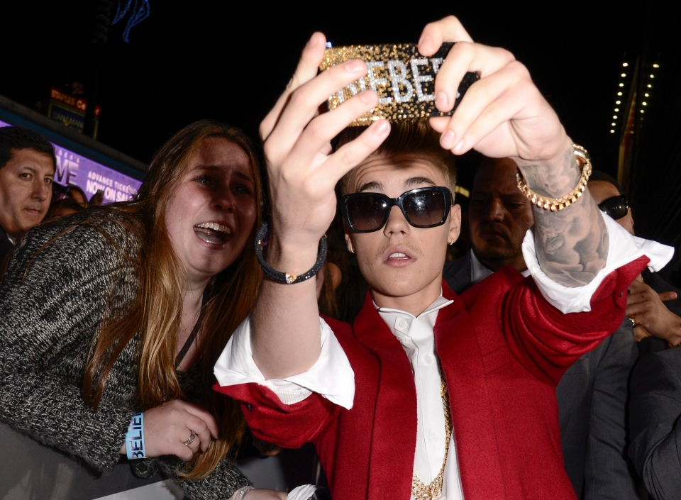 Justin Bieber takes a 'selfie' with a fan at a premiere in Los Angeles. (AP / Dan Steinberg)