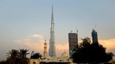 The World's tallest tower, Burj Khalifa is seen behind a mosque in Dubai, United Arab Emirates, Sunday, Aug. 7, 2011. (AP / Kamran Jebreili)