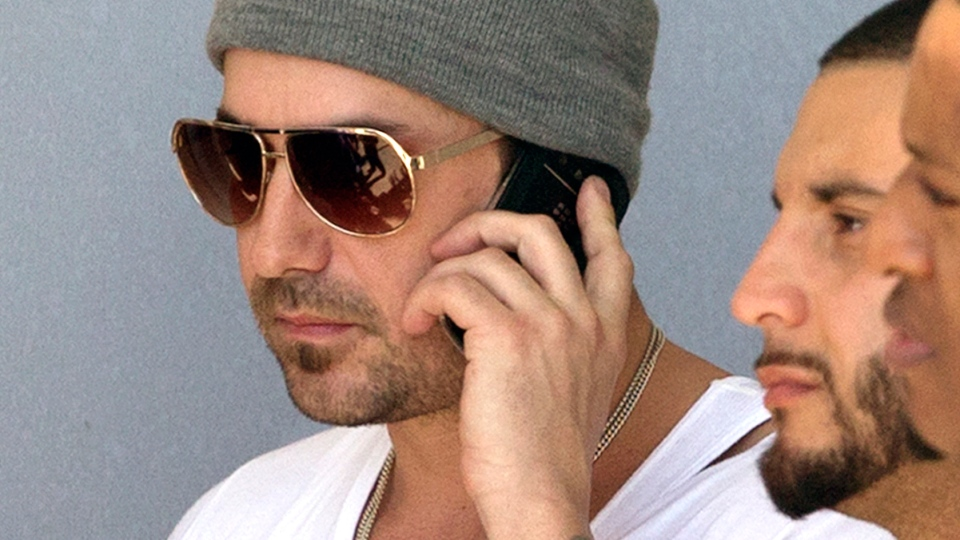 Jeremy Bieber, the father of Justin Bieber, talks on his phone outside of the Turner Guilford Knight Correctional Center in Miami, Thursday, Jan. 23, 2014. (AP / Wilfredo Lee)