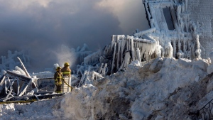 Firefighters continue to douse the rubble where fire destroyed a seniors residence in L'Isle-Verte, Que., Thursday, Jan. 23, 2014. (Ryan Remiorz / THE CANADIAN PRESS)