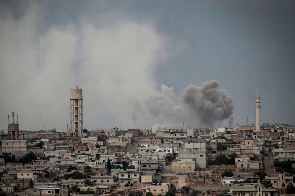 Smoke rises after a TNT bomb was thrown from a helicopter, hitting a rebel position during heavy fighting between troops loyal to president Bashar Assad and opposition fighters, in a neighbouring village to Kafr Nabuda, in the Idlib province countryside, Syria, Thursday, Sept. 19, 2013. (AP)
